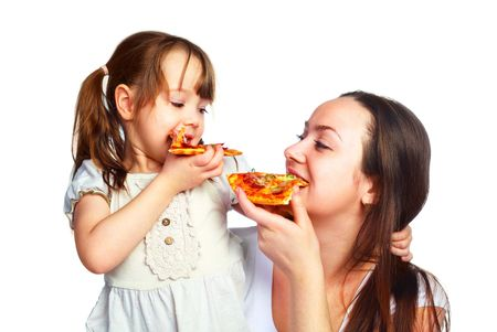young mother and her little daughter eating pizza and having fun