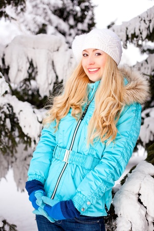 beautiful happy young blond woman in winter park