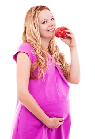 beautiful young pregnant woman with an apple, isolated against white background