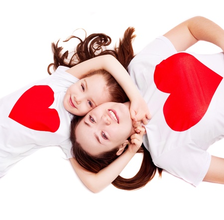 Photo pour happy mother and her six year old daughter wearing T-shirts with big red hearts, isolated against white background, top view - image libre de droit