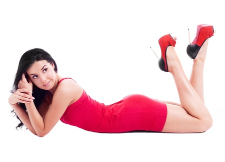 beautiful  brunette woman wearing a red dress, isolated against white background