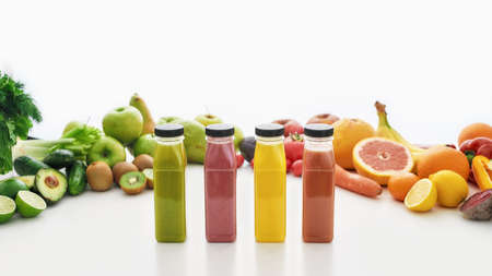 Photo for Composition of bottles of healthy detox juices and smoothies with various colorful fruits and vegetables isolated over white background - Royalty Free Image