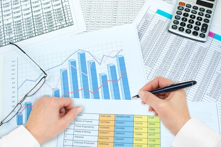 Photo pour Financial Charts, graphs, coins, calculator on isolated white background. - image libre de droit
