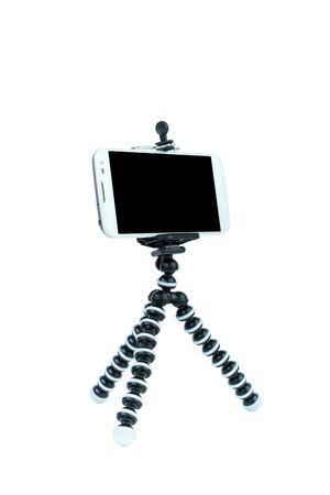 Foto de Smart Phone with a tripod on isolated white background. - Imagen libre de derechos