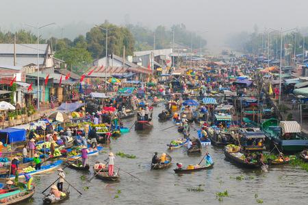 Nga Nam floating market in sunrise in Soc Trang, Vietnam. Nga Nam market is the convergent point of five rivers which flow into five different directions.