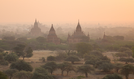Ancient Buddhist temples at sunrise in Bagan, Myanmar. Bagan is an ancient city and one of Asias most important archeological sites.