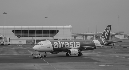Kuala Lumpur, Malaysia - Dec 16, 2015. An AirAsia aircraft at the KLIA Airport in Kuala Lumpur, Malaysia. KLIA is the world 23rd-busiest airport by total passenger traffic.