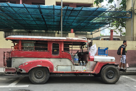 MANILA, PHILIPPINES - APR 3, 2017. Jeepney on the street in Manila, Philippines. Jeepney is a most popular public transport on Philippines.