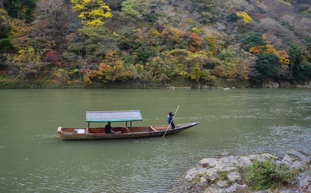 Kyoto, Japan - Nov 28, 2016. Landscape of Hozu River at Arashiyama in Kyoto, Japan. Arashiyama is a nationally designated Historic Site and Place of Scenic Beauty.