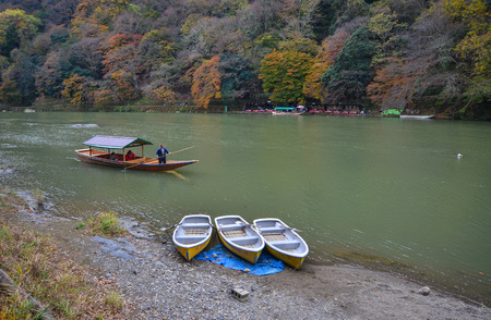 Kyoto, Japan - Nov 28, 2016. Autumn scenery of Hozu River at Arashiyama in Kyoto, Japan. Arashiyama is a nationally designated Historic Site and Place of Scenic Beauty.