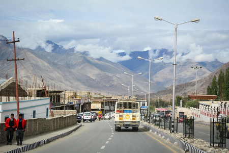 Ladakh, India - Jul 20, 2015. Cars run on street at downtown in Leh, Ladakh, India. Ladakh is one of the most sparsely populated regions in Jammu and Kashmir.