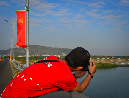 Vung Tau, Vietnam - Feb 6, 2018. A man taking pictures in Vung Tau, Vietnam.