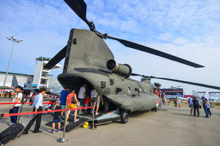 Singapore  - Feb 10, 2018. People visit a Boeing CH-47 Chinook helicopter belong to the Singapore Air Force at the 2018 Singapore Airshow.