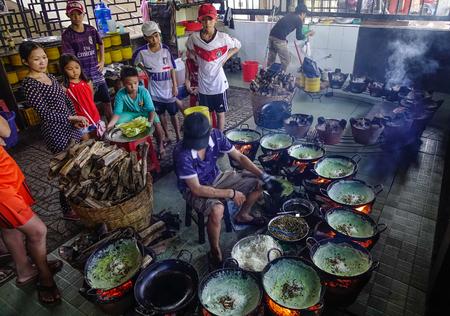 An Giang, Vietnam - Sep 2, 2017. A man making traditional cake in An Giang, Vietnam. An Giang is a province in southern Vietnam, bordering Cambodia.
