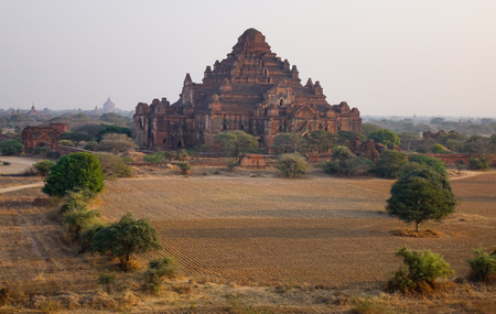 A Buddhist temple at sunrise in Bagan, Myanmar. Bagan is home to the largest and densest concentration of Buddhist temples and pagodas.