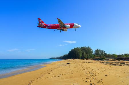 Phuket, Thailand - Apr 4, 2019. Thai AirAsia HS-ABK Airbus A320 landing above the sand beach near Phuket Airport (HKT).