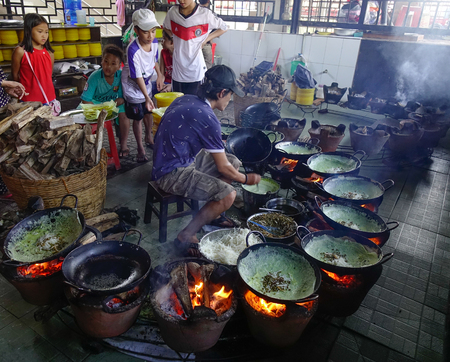 Can Tho, Vietnam - Sep 6, 2017. Cooking sizzling pancake (Vietnamese Banh Xeo) at local restaurant in Can Tho, Vietnam.
