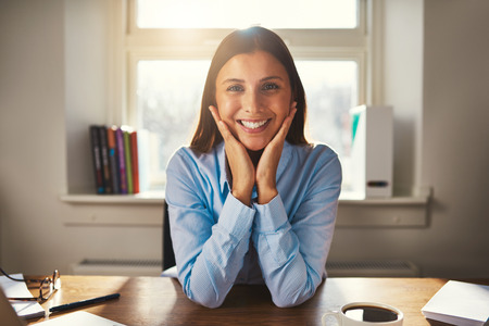 Female entrepreneur business woman smiling at camera working at office