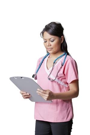 Nurse holding patient's chart