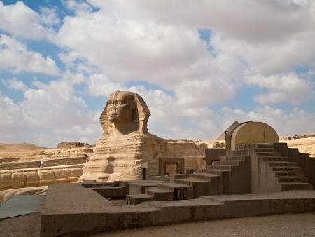 Commonly referred to as the Sphinx, is a statue of a reclining or couch-ant sphinx that stands on the Giza Plateau on the west bank of the Nile in Giza, Egypt