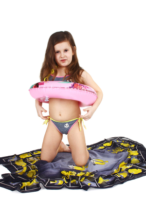 Photo for little child in swim suit with tube in studio - Royalty Free Image