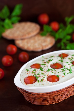 Quark and cherry tomatoes steam savory pudding, selective focus