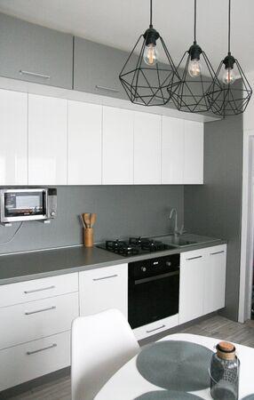 Foto de White Kitchen Design. Scandinavian, Clean, Simple Kitchen Interior. Modern Home, Monimalism. - Imagen libre de derechos