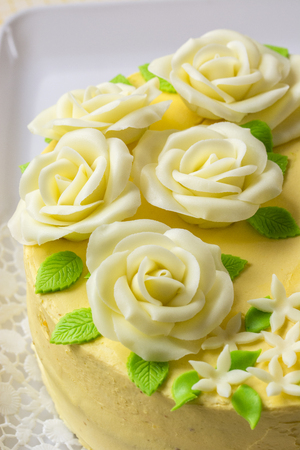 Butter yellow cake with marzipan roses.