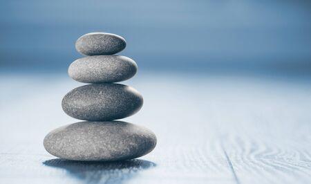 Photo pour Stack of Zen Stones on blue background. - image libre de droit