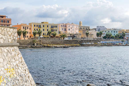 Photo pour A view of Civitavecchia, also known as Port of Rome, showing the Pirgo beach and the coastal street Thaon De Revel with its residential buildings, Church of the Holy Japanese Martyrs and the small harbor of Lega Navale - image libre de droit