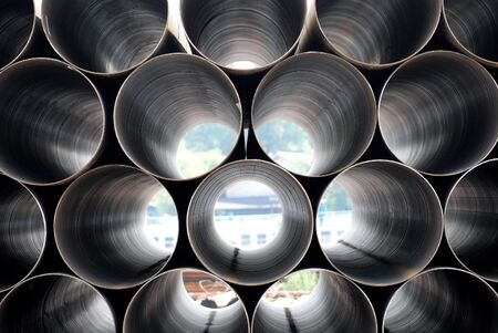 Photo pour Stack of iron pipes. Industrial material - image libre de droit