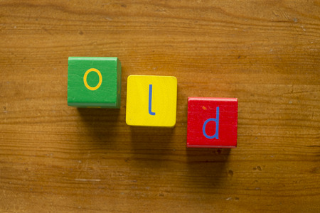 Colorful wooden blocks spelling the word OLD
