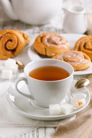 Cup of tea with sugar and cinnamon buns