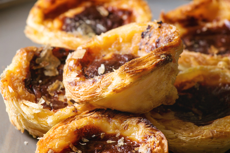 Traditional Portuguese egg tart dessert Pasteis Pastel de nata. Close up