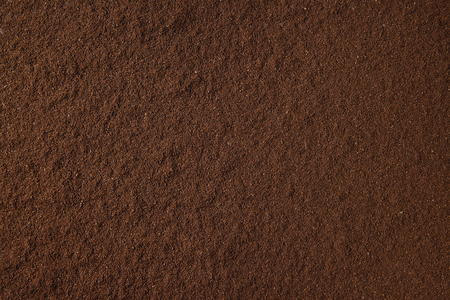 Foto de Ground black coffee food abstract background. - Imagen libre de derechos