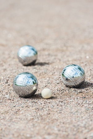 Game of boule being played on sand