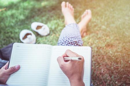 Photo pour Women write notes Nature trails, mountains, forests. Writer - image libre de droit