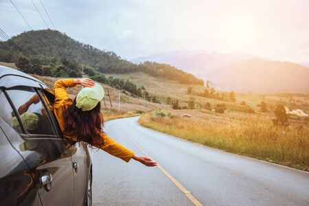 Photo pour Asian women travel relax in the holiday. driving a car traveling happily. - image libre de droit