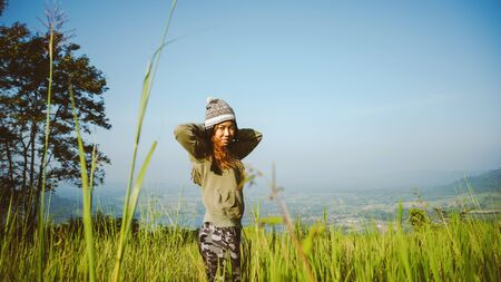 Asian woman travel nature in the holiday green mountains range. Travel relax.
