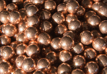 BBs are jumbled up in a closeup in bright light