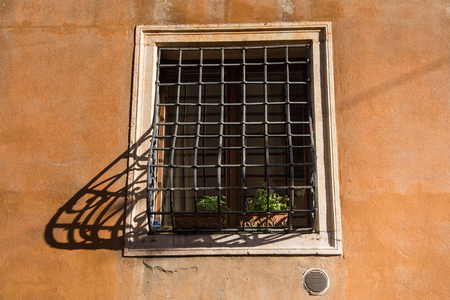 Photo for window with grates in venice,shadow bars,Italy,2019 - Royalty Free Image