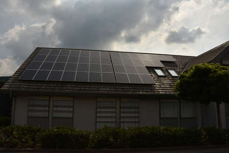 Photo pour Solar panel cells on the roof of a new house in Germany - image libre de droit