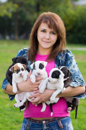 Young Women Holding Five Little Puppies American Staffordshire Terrier