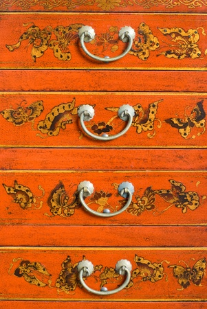Old Chinese cabinet with traditional painting and handles