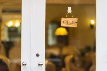 Foto de Open sign hanging on door of a store. - Imagen libre de derechos