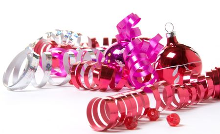 Brightly colored Christmas ornaments and curly ribbon