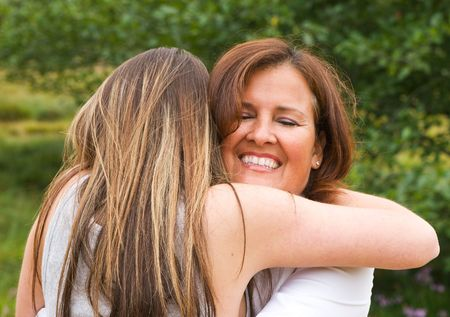 Mom with teen daughter receiving a hug