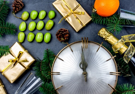 NEW YEAR TRADITION. Latin American and Spanish New Year traditional. Funny ritual to eat twelve 12 grapes for good luck at midnigth. Flat lay, top view. Christmas New Year composition.