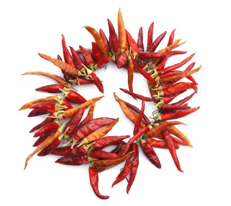 Dried red peppers on a white background