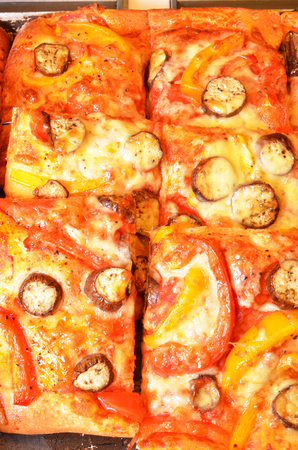 Pizza breads with chess and vegetables at the bakery